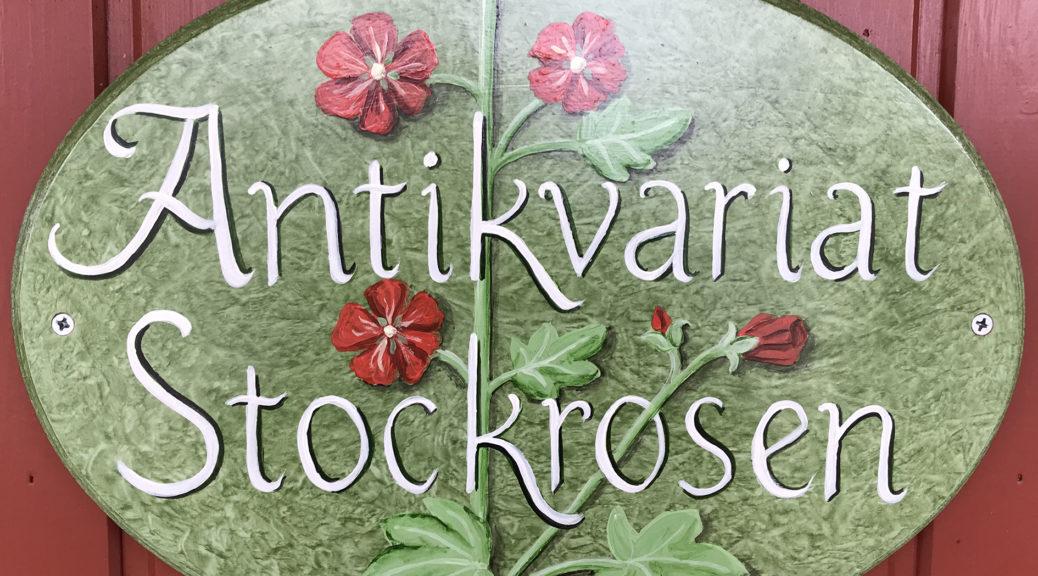Antikvariat Stockrosen skylt